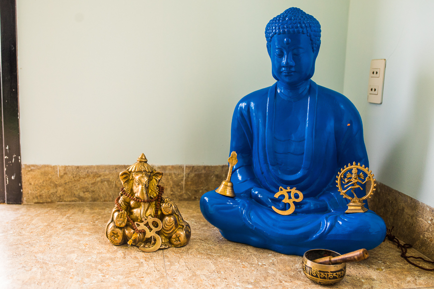 Bright blue Buddha at a yoga studio.