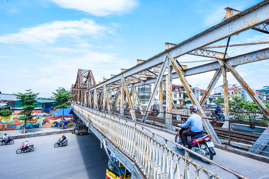 Crossing Long Bien Bridge in Hanoi.
